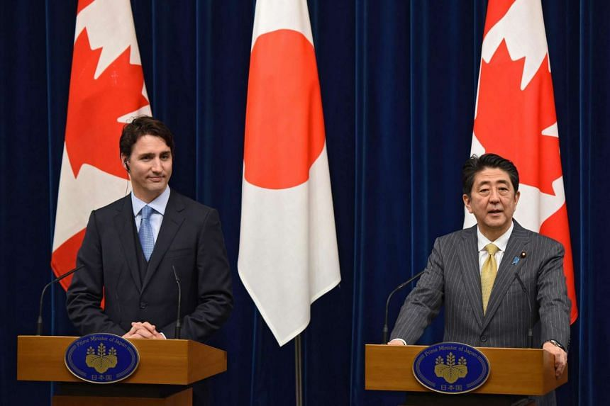Canadian Prime Minister Justin Trudeau (left) and Japanese Prime Minister Shinzo Abe hold a press conference after their talks at Abe's official residence in Tokyo, on May 24, 2016.