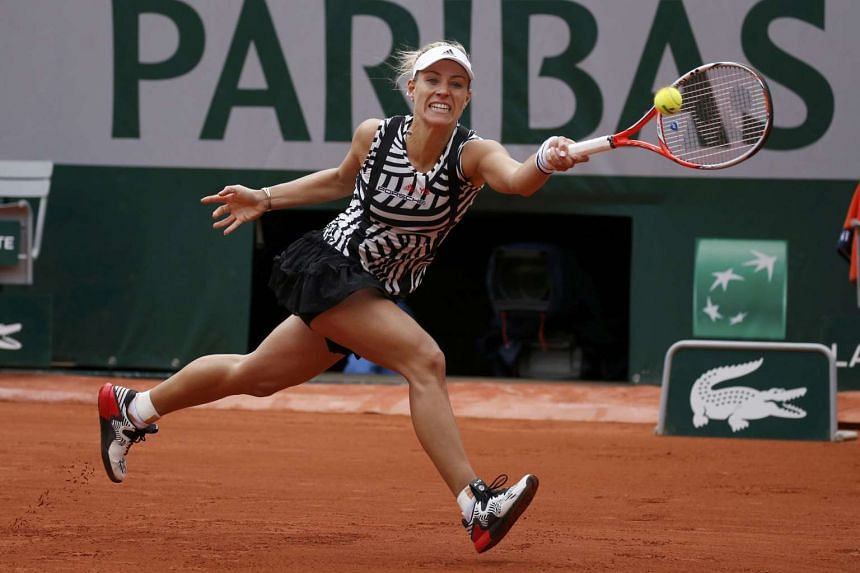 Angelique Kerber (above) returns the ball to Kiki Bertens at the French Open.