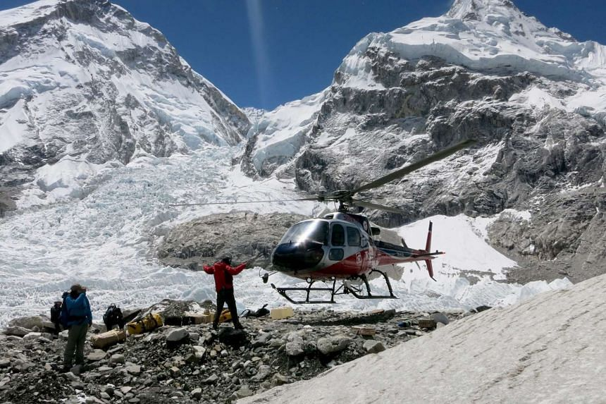 A rescue helicopter lands at Mount Everest base camp, Nepal, on May 24, 2016, in a handout provided by Nepalese climber Phurba Tenjing Sherpa.