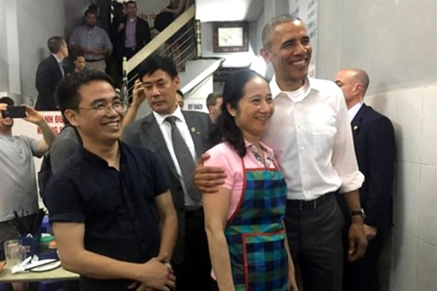 US President Obama with restaurant owner Nguyen Thi Lien in Vietnam on May 23, 2016.