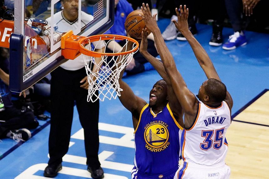 Draymond Green #23 of the Golden State Warriors shoots against Kevin Durant #35 of the Oklahoma City Thunder in game three of the Western Conference Finals during the 2016 NBA Playoffs at Chesapeake Energy Arena on May 22, 2016 in Oklahoma City, Okla