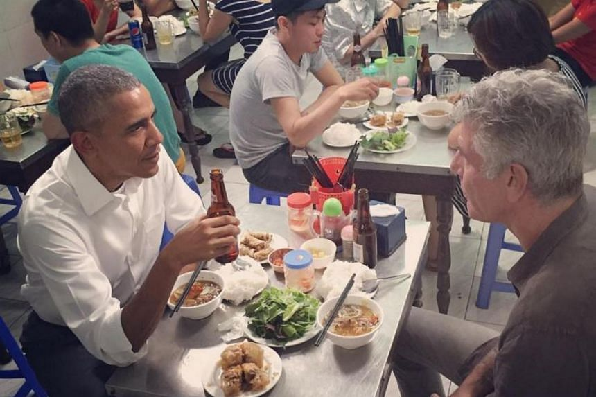 US President Barack Obama and TV host Anthony Bourdain share a bun cha meal at a packed Vietnamese restaurant in Hanoi.