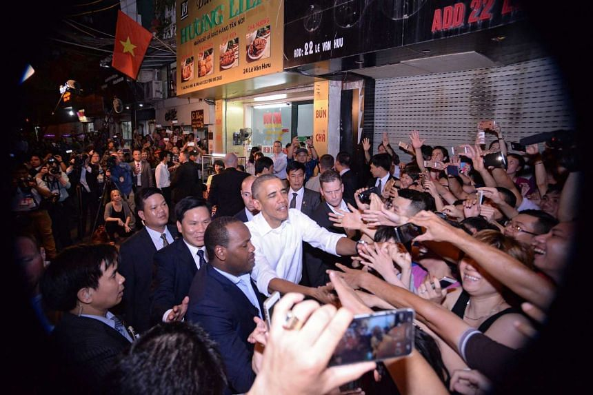 Mr Obama is mobbed by local residents after leaving the restaurant.