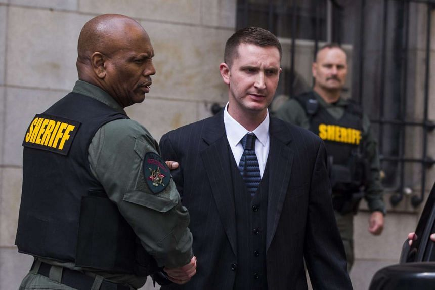 Baltimore police officer Edward Nero (centre) leaves the courthouse after being acquitted of all charges in the death of Freddie Gray on Monday (May 23).