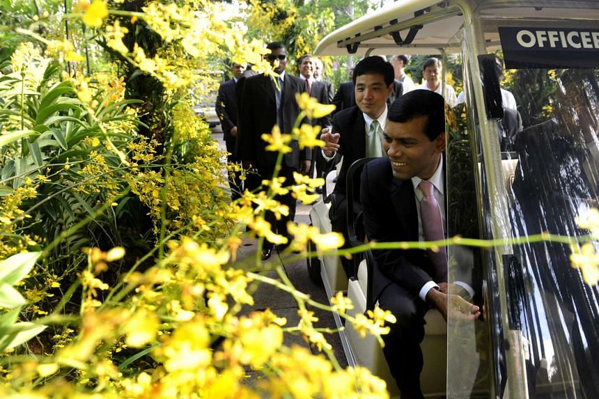 Mohamed Nasheed (front) visiting the National Orchid Garden on June 28, 2010 when he was Maldives president during a two-day official visit.