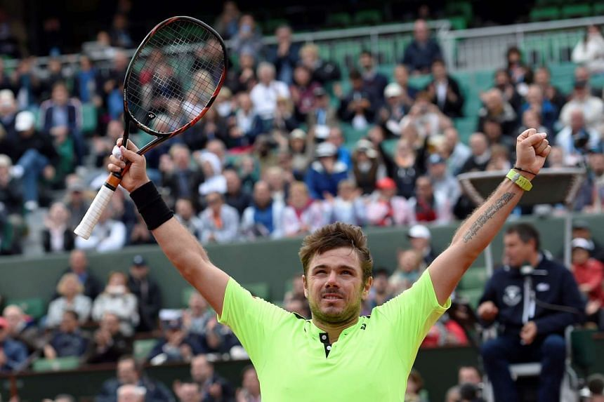 Stanislas Wawrinka reacts after beating Lukas Rosol during their men's first round match at Roland Garros on Monday.