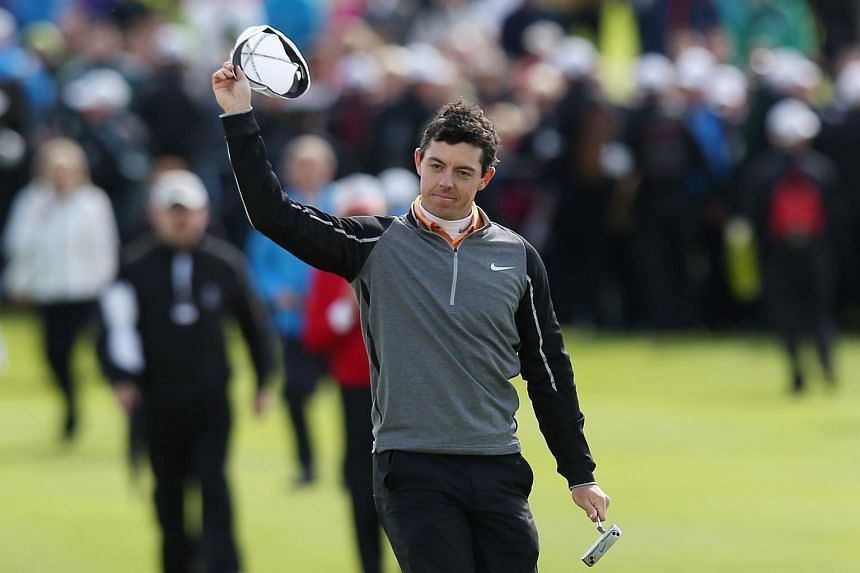 Rory McIlroy waves to spectators as he walks onto the 18th green before winning the Dubai Duty Free Irish Open.