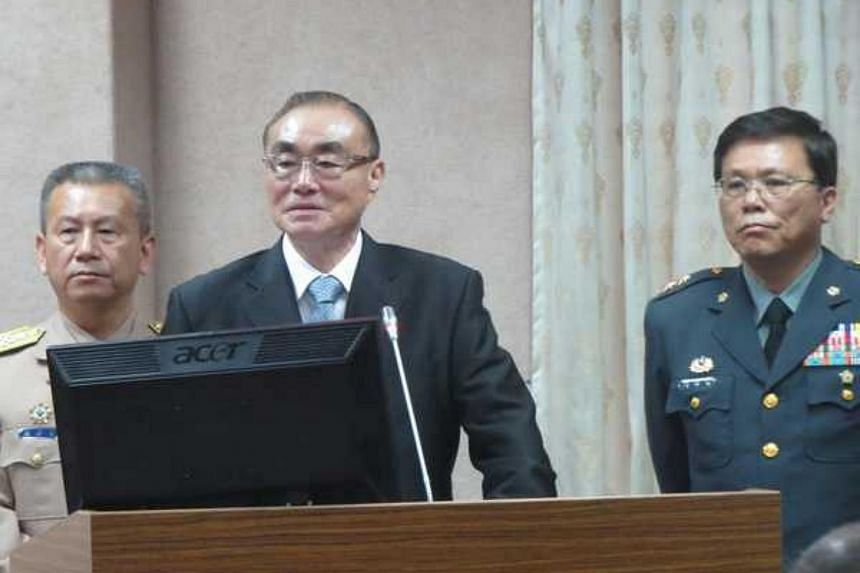 Defense Minister Feng Shih-kuan (centre) attends the first interpellation session of his tenure at the Legislative Yuan in Taipei on May 23.