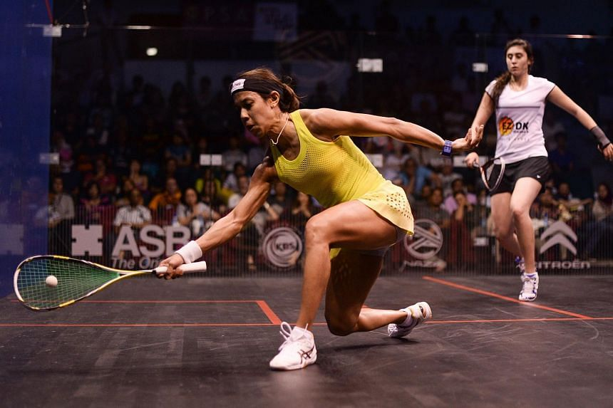 Nicol David of Malaysia (left) plays a forehand against Nour El Sherbini of Egypt during their quarter-final match of the PSA Women's World Championships squash tournament.