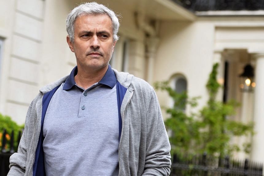 Jose Mourinho leaving his London home yesterday, as British media reported that he was to be appointed by Manchester United as Louis van Gaal's successor.