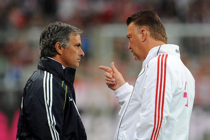 A file photograph shows Louis van Gaal (right) with Jose Mourinho prior to a friendly match between FC Bayern Munich and Real Madrid.