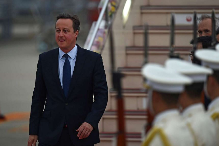 Britain's Prime Minister David Cameron arrives at Chubu Centrair International Airport at Tokoname, Aichi prefecture on May 25, 2016 ahead of the 2016 Ise-Shima G7 Summit.