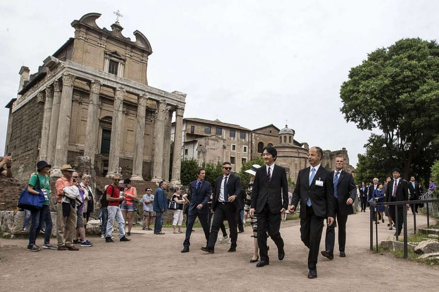 Members of the Japanese imperial family during their visit to the Roman Forum, a rectangular plaza surrounded by the ruins of several important ancient government buildings, in Rome, Italy, on May 11, 2016.