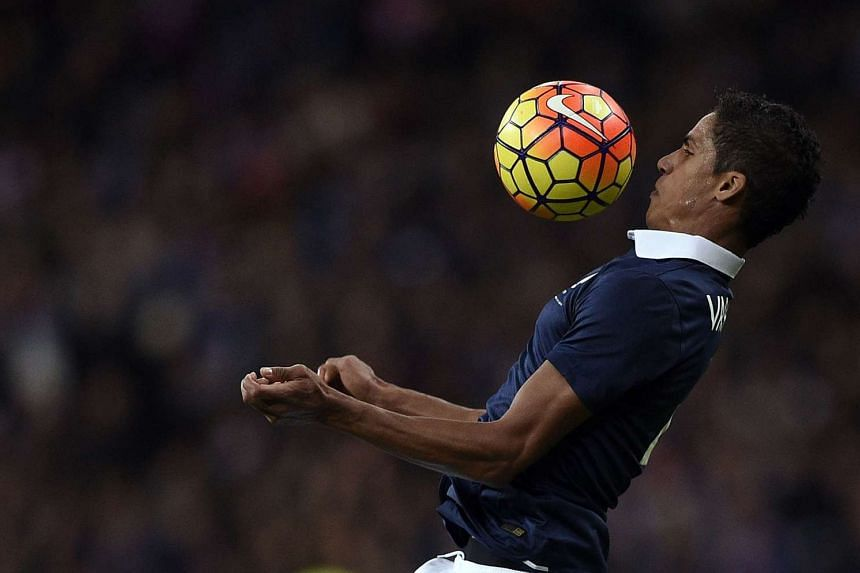 French defender Raphael Varane controlling the ball during a friendly international football match between France and Germany ahead of the Euro 2016, on Nov 13, 2015 at the Stade de France stadium in Saint-Denis, north of Paris.