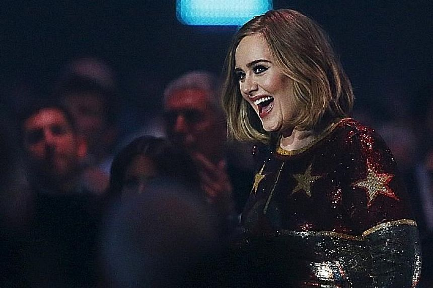 British singer Adele, seen here at the Brit Awards held in London in February, was the best-selling artist in the world last year.