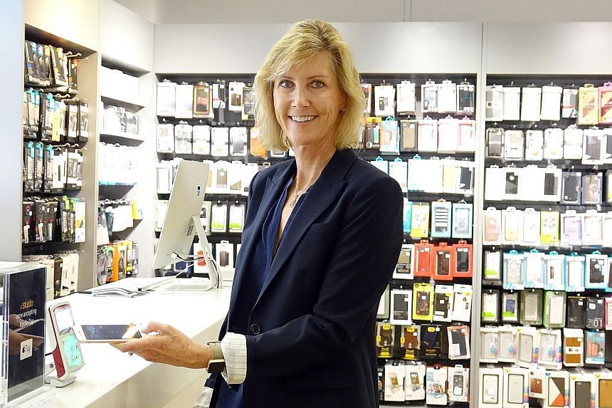 Apple Pay vice-president Jennifer Bailey (above) demonstrating the e-wallet system at the iStudio retail shop in Paragon mall yesterday. The five major banks here that have signed up to the system are POSB, DBS Bank, OCBC Bank, UOB and Standard Chartered