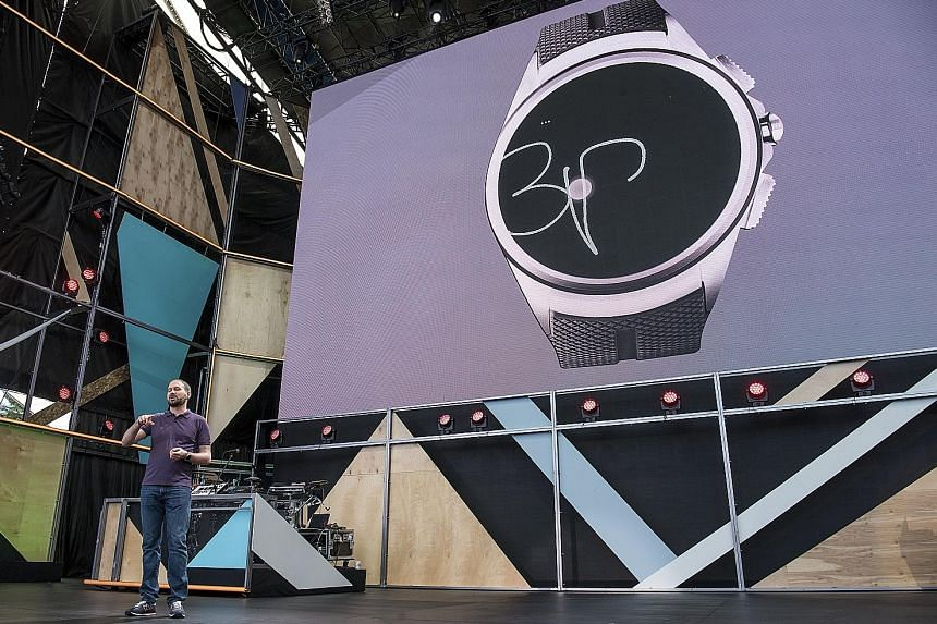 Mr David Singleton, Google's director of Android engineering, showing the audience at the Google I/O event last week how, with Android Wear 2.0, users can write on their watches using their fingers.