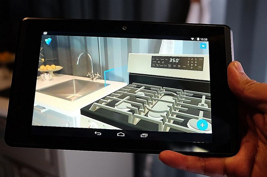 Google shows off its augmented reality software, named Project Tango, at Google I/O 2016. It allows users to overlay virtual furniture in real time over a live view of their home.