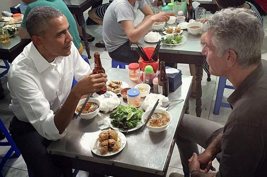 "US President Barack Obama slipping away from his hectic Vietnam visit to sample ""bun cha"", or fatty pork noodle soup, at a Hanoi restaurant on Monday with chef Anthony Bourdain, who fronts a travel show about culinary gems around the world. Mr Bourda"