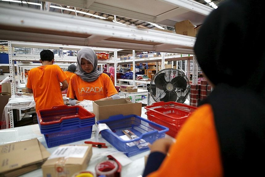 An employee at online retailer Lazada filling an order at a warehouse in Jakarta, Indonesia. South-east Asia's Internet user base of 260 million is expected to grow to 480 million by 2020, says Google.