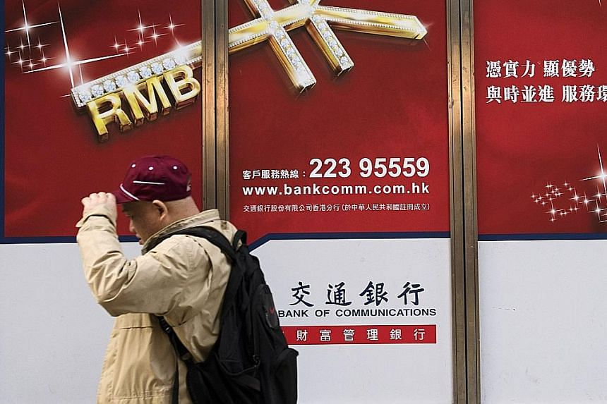 WSJ cited people close to the PBOC as saying that the bank guides the daily direction of the currency by alternating between setting the yuan's value against the dollar and against a basket of currencies.