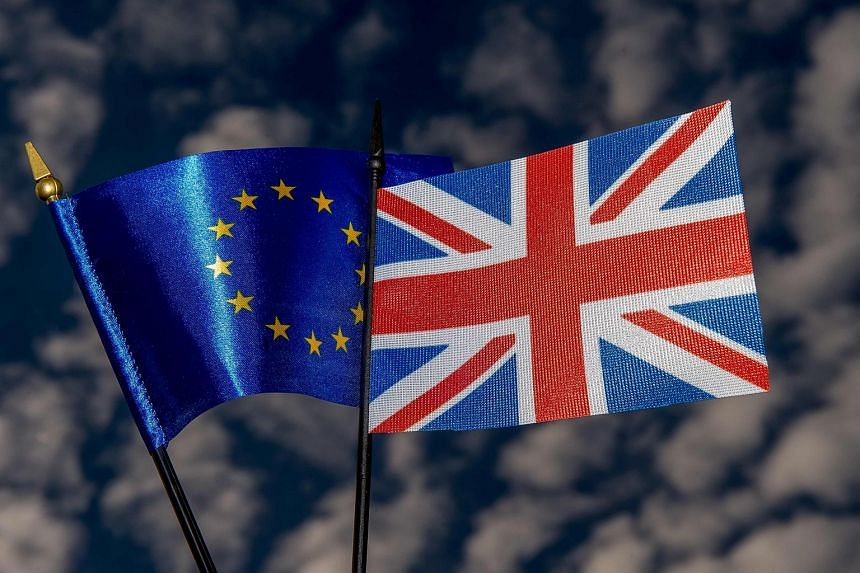 This photo illustration created on May 20 in Lille shows the flags of the European Union and the United Kingdom ahead of the British referendum on exiting the European Union.