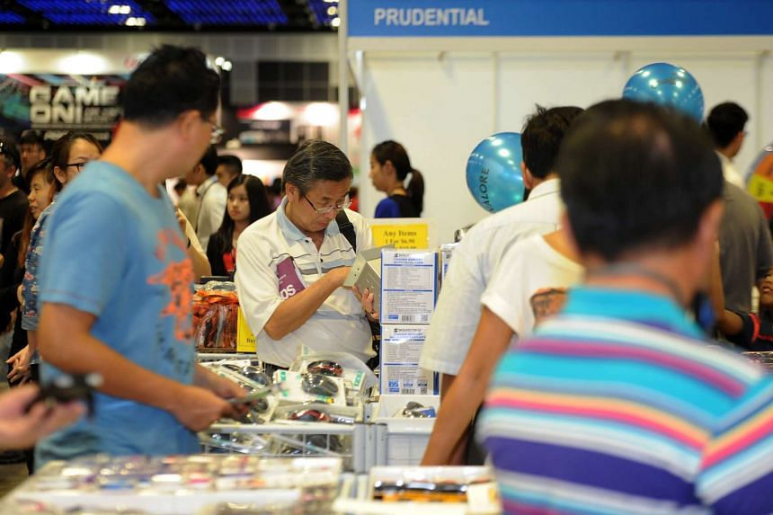 Potential buyers checking out deals at the Consumer Electronics Exhibition at Suntec Singapore on May 29, 2015.
