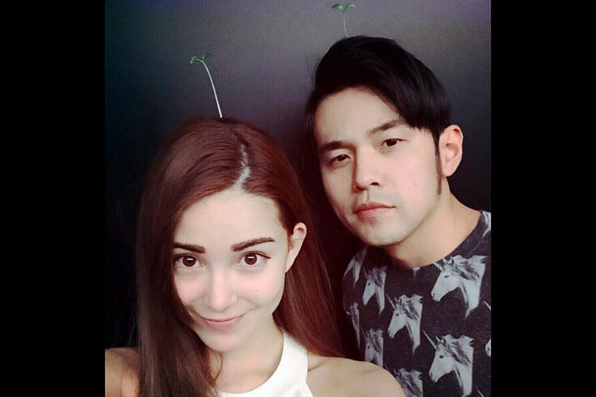 Jay Chou and his wife, Hannah Quinlivan, wearing bean sprouts on their heads.
