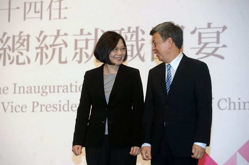 Taiwan's new President Tsai Ing-wen chatting with Vice-president Chen Chien-jen during a banquet in Taipei.