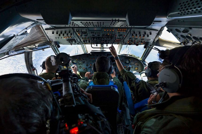 French soliders aboard an aircraft carrying out searches for debris from the crashed EgyptAir flight MS804, over the Mediterranean Sea on May 22, 2016.