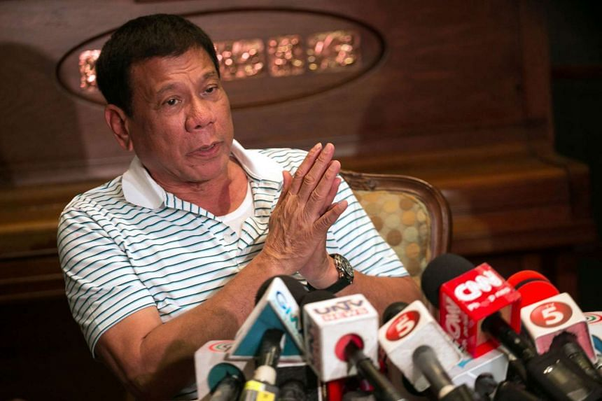 Philippines' president-elect Rodrigo Duterte gestures as he speaks during a press conference in Davao City on May 23, 2016.