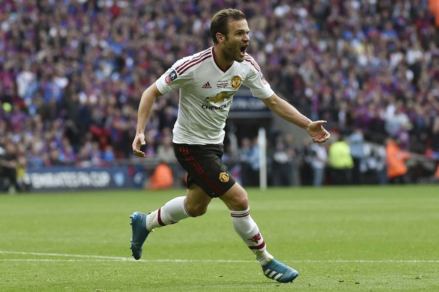 Juan Mata celebrates after scoring the first goal for Manchester United during the FA Cup final.