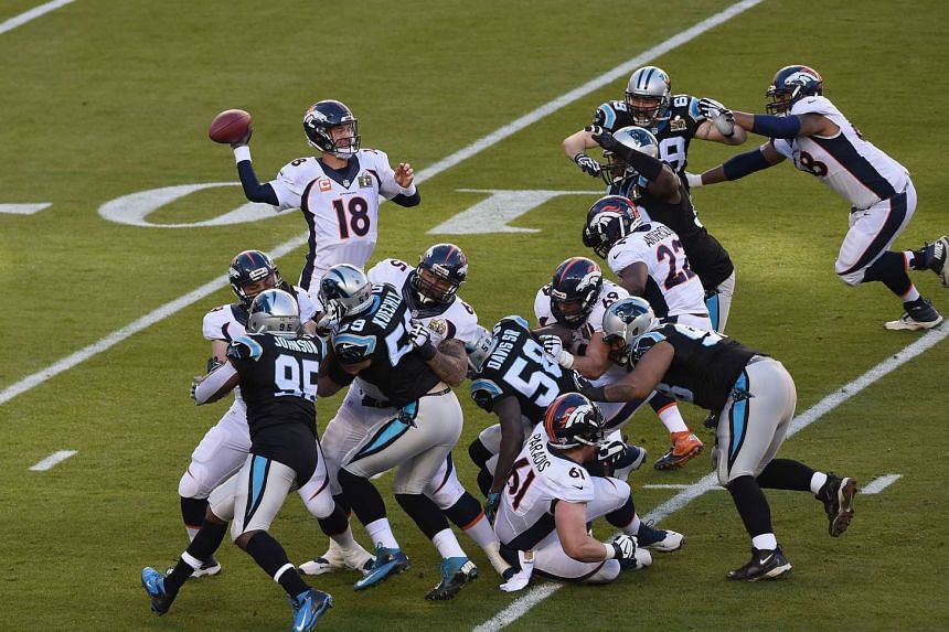 Quarterback Peyton Manning #18 of the Denver Broncos looks to pass against the Carolina Panthers during Super Bowl 50.