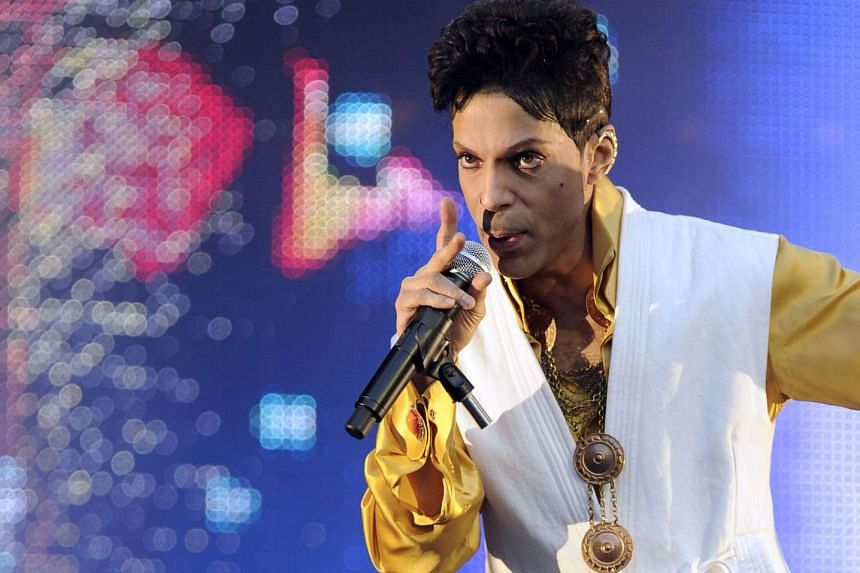 US singer and musician Prince performing on stage at the Stade de France in Saint-Denis, outside Paris.