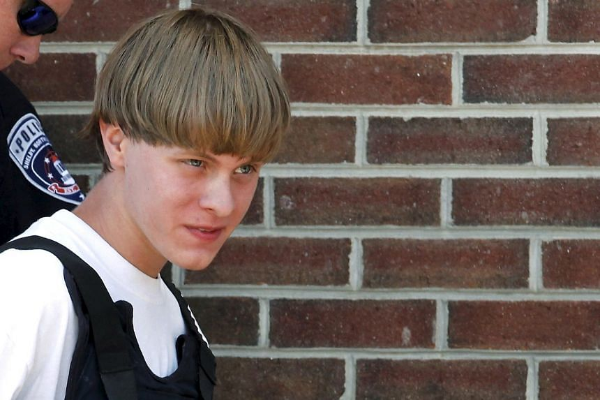 Dylann Roof is escorted by police in a June 18, 2015, file photo.