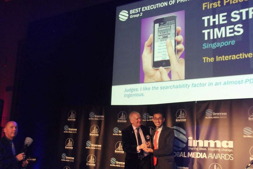 Head of operations for SPH's marketing division Jerry Siah on stage to receive an award.