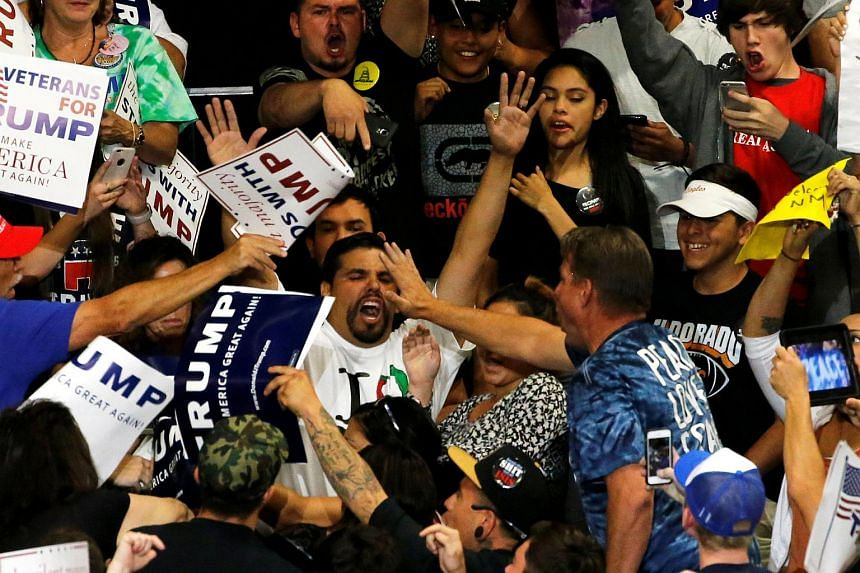 A protester disrupts a rally with Republican US presidential candidate Donald Trump and his supporters in Albuquerque, New Mexico, US on May 24.