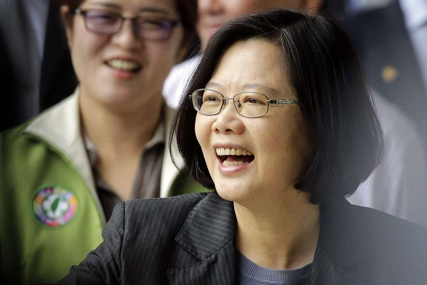 Taiwan President Tsai Ing-wen smiles at supporters as she arrives to vote for party officials in Taipei.