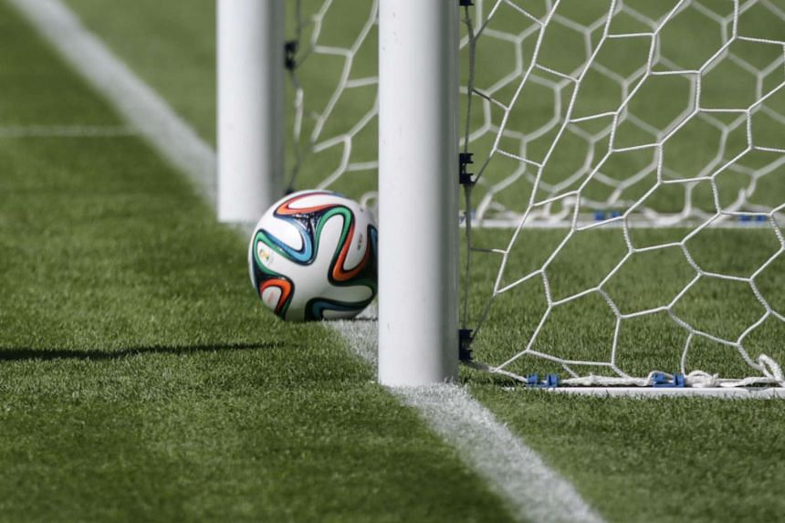 A football on the line of the goal during a presentation of the goal-line technology to give more accuracy to referees, in Rio de Janeiro on June 9, 2014.