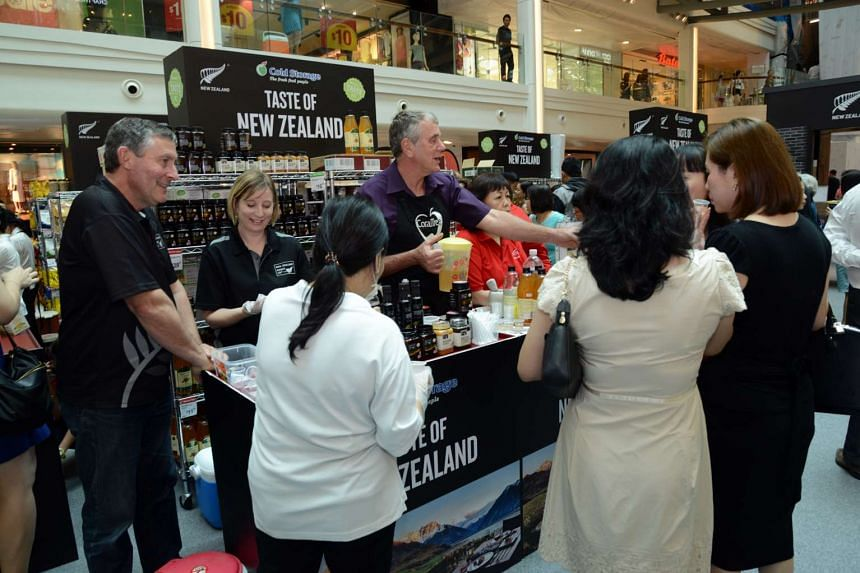 A crowd sampling apple cider vinegar at Cold Storage's Taste New Zealand, happening now to May 29 at Plaza Singapura atrium.