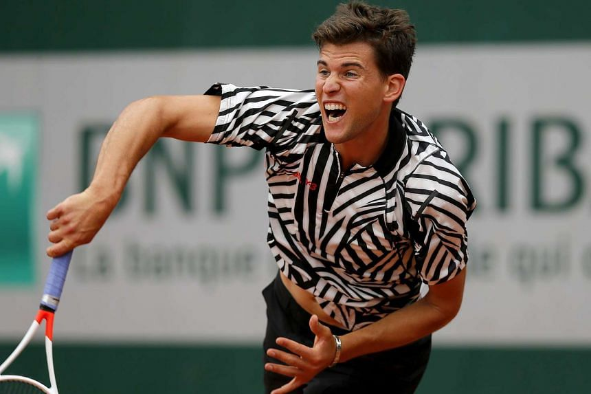 Dominic Thiem of Austria in a shirt with black and white zebra stripes at the French Open on May 26, 2016.