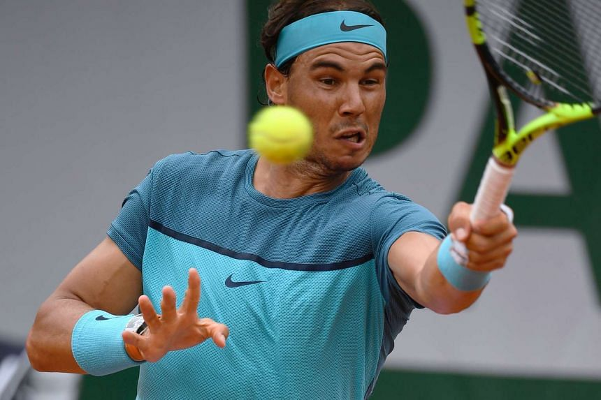 Rafael Nadal returns the ball during the men's second round match at the Roland Garros 2016 French Tennis Open in Paris, on May 26, 2016.