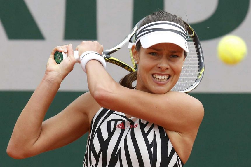 Ana Ivanovic of Serbia sporting a shirt with black and white zebra stripes at the French Open on May 26, 2016.