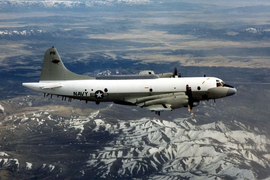A US Navy EP-3 flying over an unknown location, in an undated handout picture provided by the US Department of Defence.
