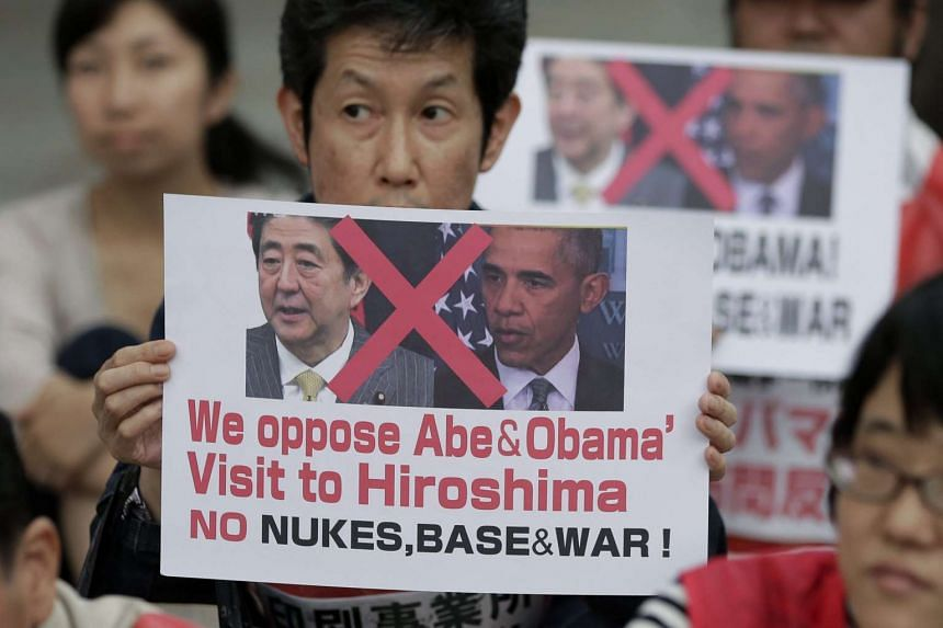 People protesting against the visit to Hiroshima by Japanese Prime Minister Shinzo Abe and US President Barack Obama at Hiroshima Peace Memorial Park on May 26, 2016.