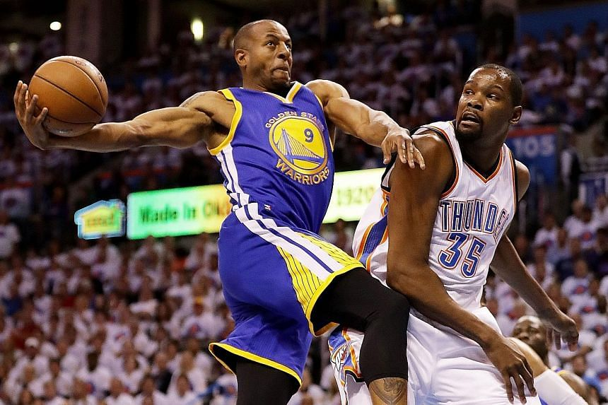 Warriors' Andre Iguodala (left) tussling with Thunder's Kevin Durant in game four of the Western Conference finals on Tuesday.