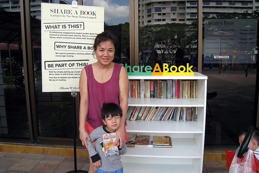 Nee Soon resident Meyar Lwin, 34, says she has taken a few comic books for her son from the neighbourhood's book exchange corner, which is located outside the town council office at Block 290, Yishun Street 22.