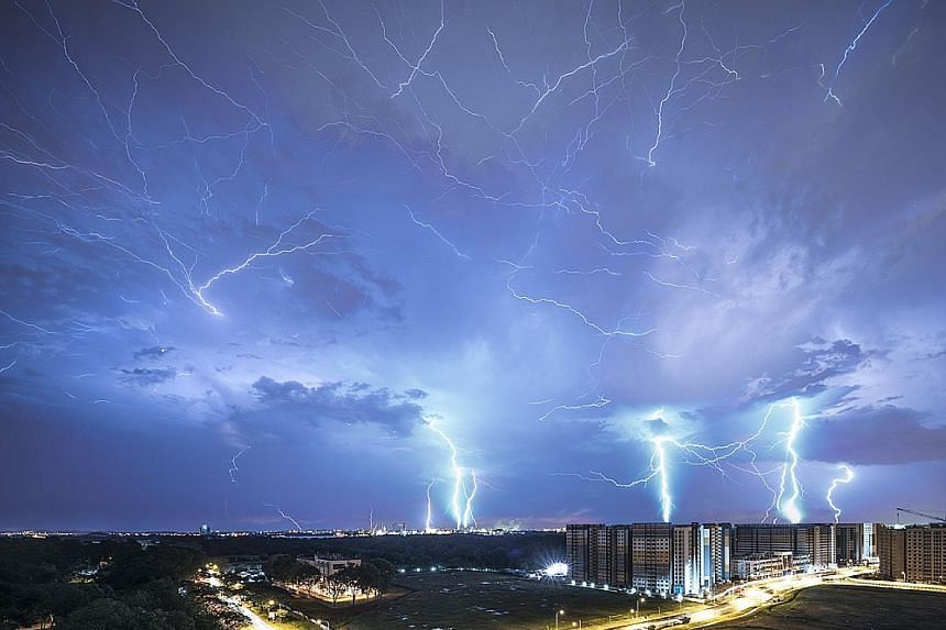 Mr Soh took about 100 images of lightning flashing across the night sky. He then selected 12 images and used Photoshop to layer them into a single composite image.