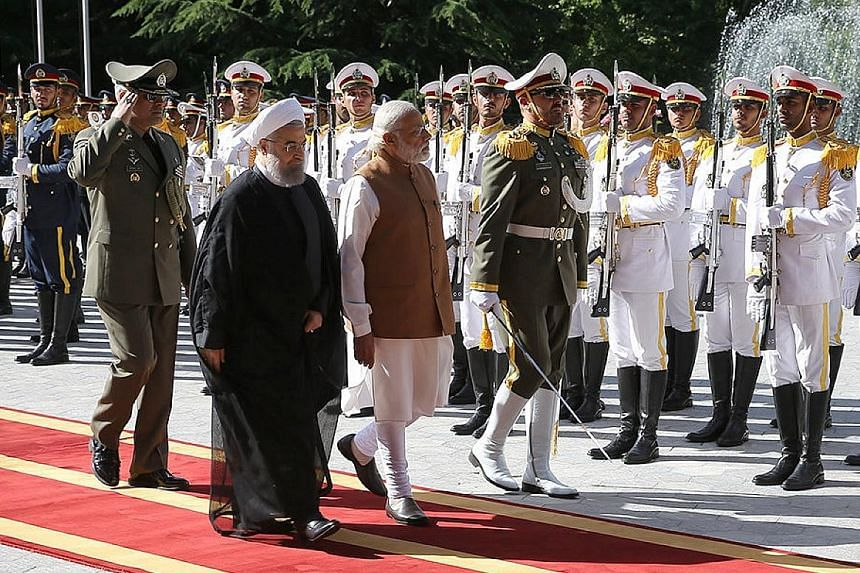 Mr Modi (right) inspecting a guard of honour with Iranian President Hassan Rouhani during a visit to Teheran on Monday.