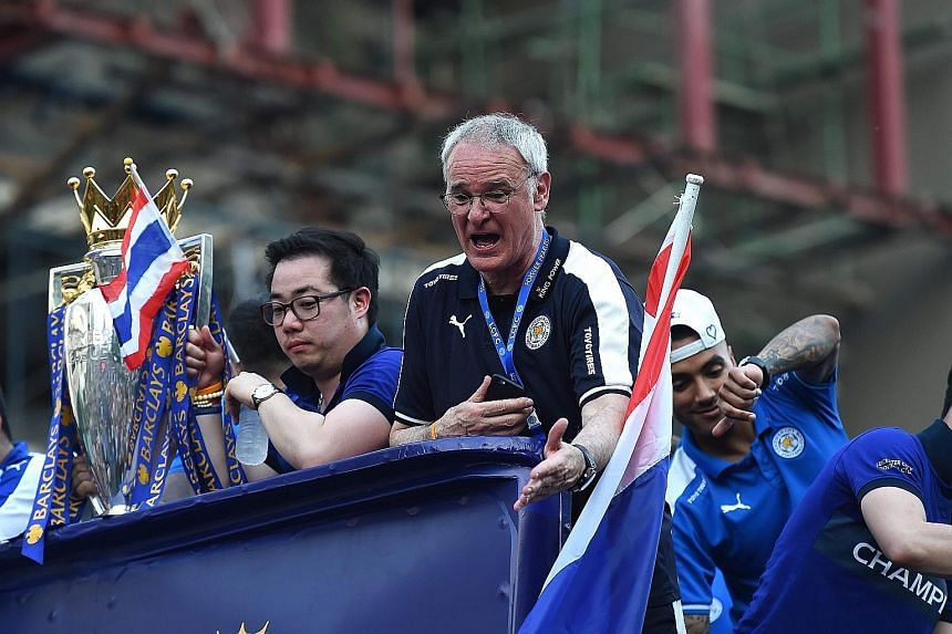 Leicester City manager Claudio Ranieri and his players showing their delight during an open-bus parade in Bangkok last week. Vice-chairman Aiyawatt Srivaddhanaprabha, son of the owner, is holding the Premier League trophy.